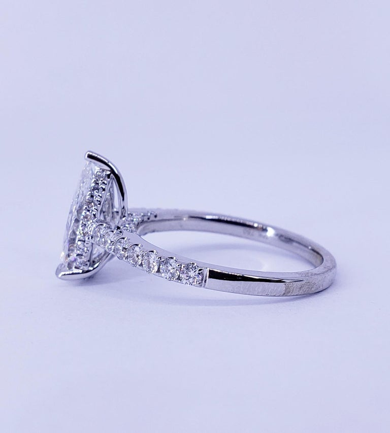 Rosenberg Diamonds & Co. 1.53 carat Pear shape D color VS2 clarity is accompanied by a GIA certificate. This breathtaking Pear shape is full of brilliance and it is set in a handmade 18 karat white gold setting. This ring continues its elegance with