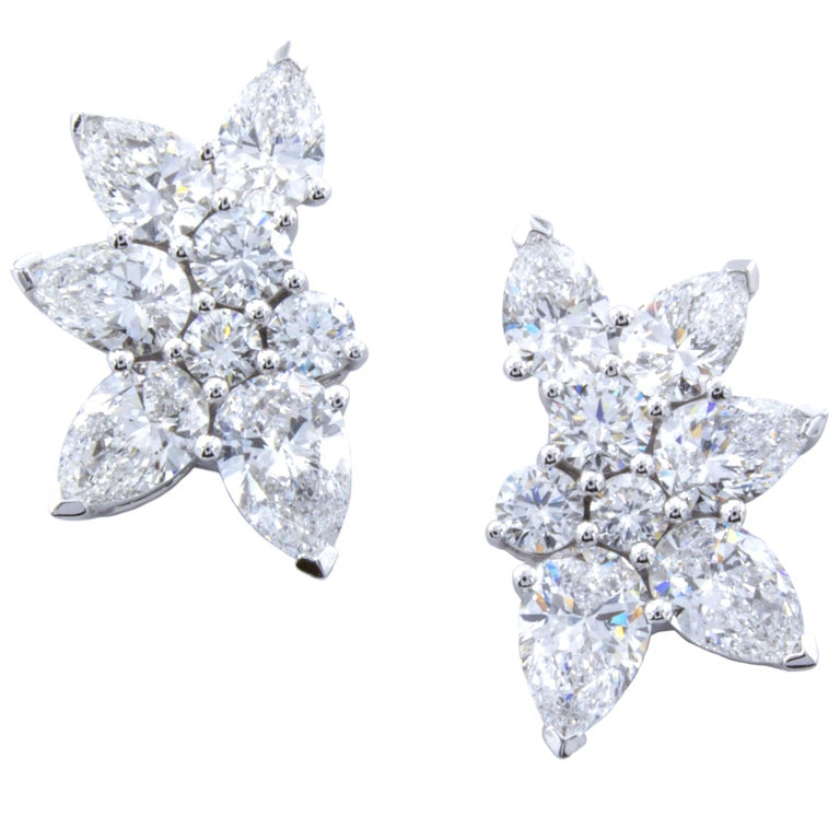 34f4de7dd A wonderfully designed pair of diamond stud earrings employ a cluster style  setting. 18Kt white