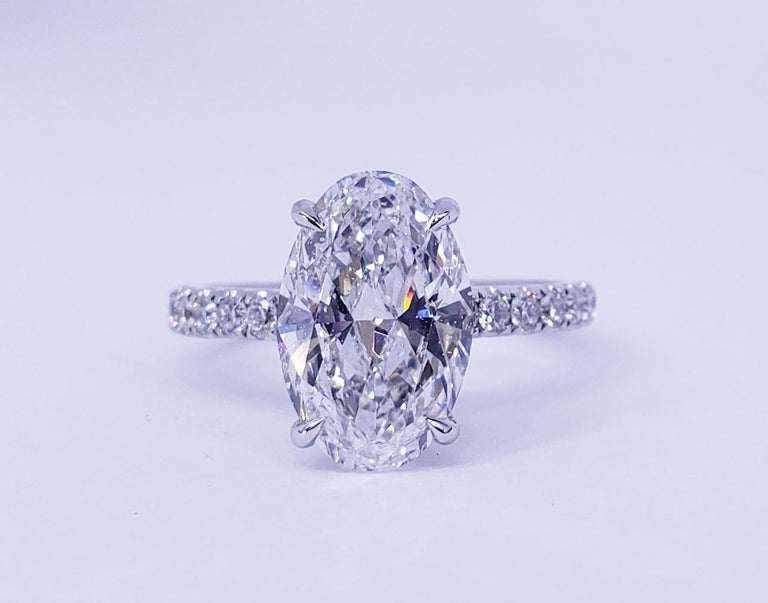 Rosenberg Diamonds & Co. 3.19 carat Oval cut D color SI2 clarity is accompanied by a GIA certificate. This breathtaking Oval is full of brilliance and an exceptional SI2 that is set in a handmade 18 karat white gold setting. This ring continues its
