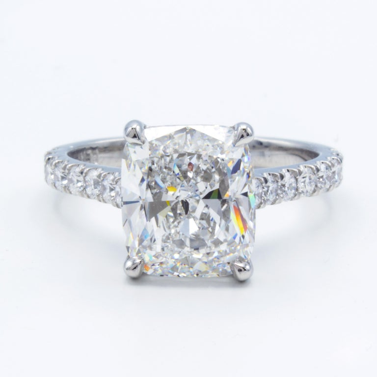 Rosenberg Diamonds & Co. 3.76 carat Cushion shape E color VVS2 Clarity is accompanied by a GIA certificate. This spectacular collection color is full brilliance that is set in a handmade platinum setting with beautiful round micro pave three