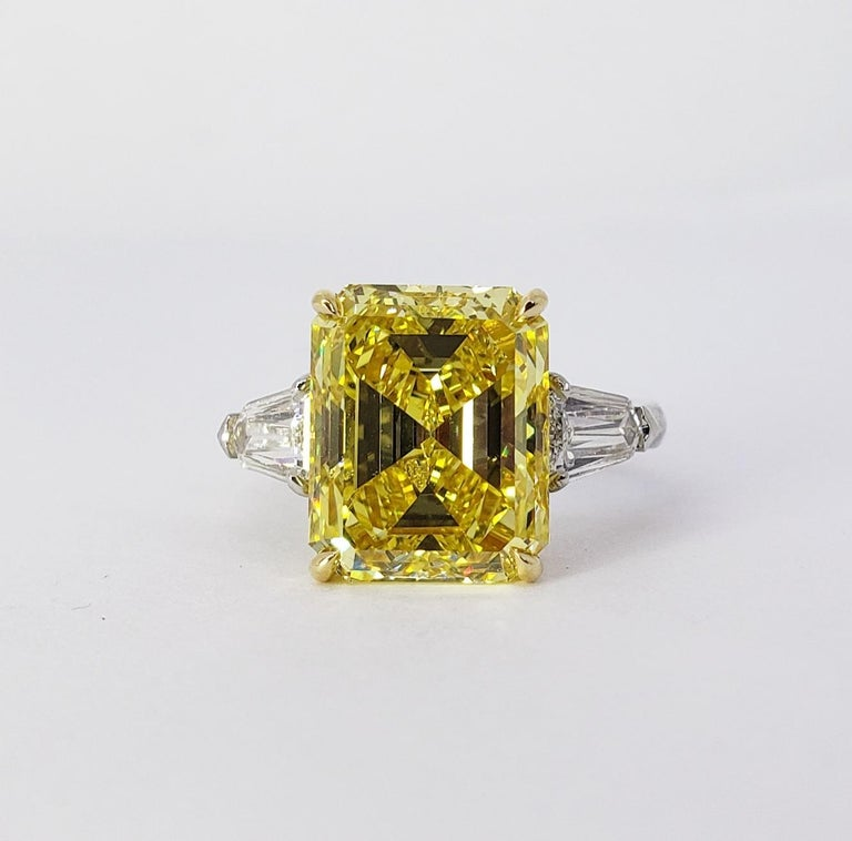 Rosenberg Diamonds & Co. 6.40 carat Emerald cut Fancy Vivd Yellow VS1 clarity is accompanied by a GIA certificate. This incredible bright Emerald is full of life and it is set in a handmade platinum and 18 karat yellow gold setting with perfectly