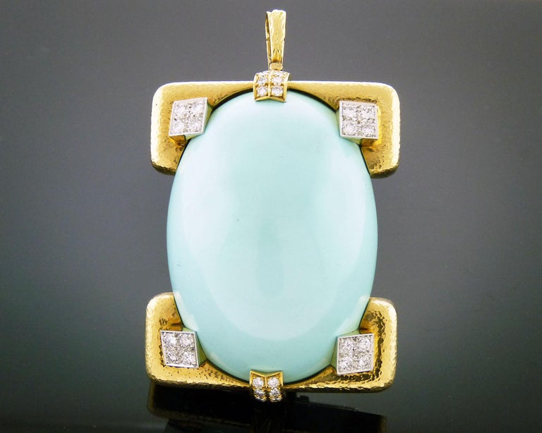 Beautiful brooch created by David Webb featuring a cabochon turquoise of approximately 211.37 carats, 2.00 carats of round diamonds set in 18K yellow gold and platinum. Style No.: 17156C Serial No.: HP15  Signed David Webb Accompanied by the