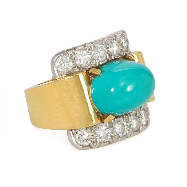 A gold, diamond, and turquoise cocktail ring featuring a horizontally set turquoise in a diamond plaque setting bisected by a gold band, in 18k and platinum.  David Webb.  Atw 1.80 ct. diamonds  Current ring size: US 6 (Please contact us with