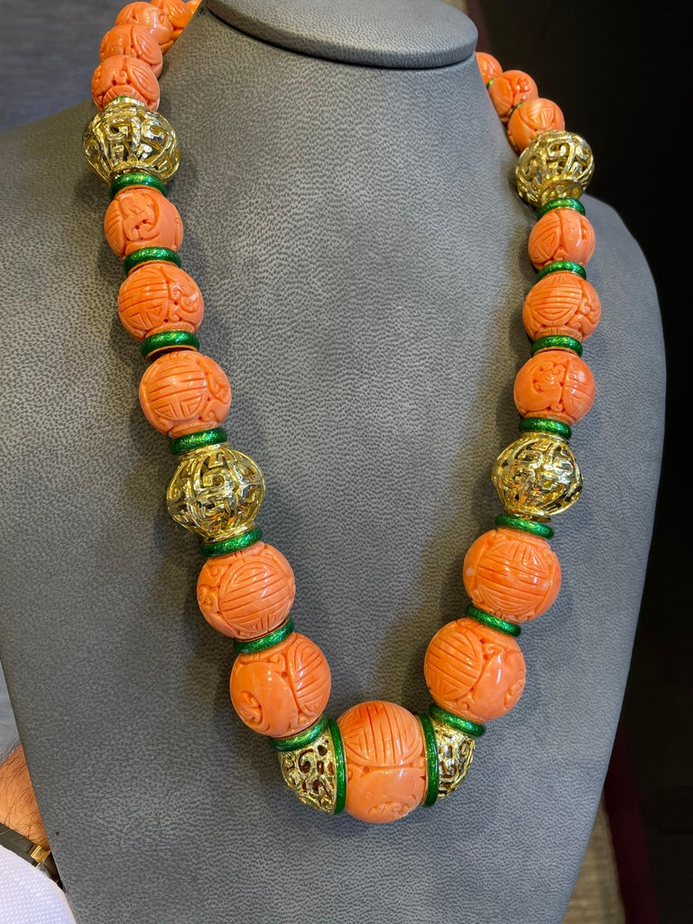 David Webb Carved Coral Necklace,  Set with museum quality large size antique carved Chinese coral beads.  Four sizes of carved coral beads: Coral beads size: large-30mm medium-25mm small-20mm xs-17.5mm  18 karat Hammered gold & green enamel