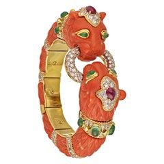 David Webb Coral Double Lion Head Bangle Bracelet