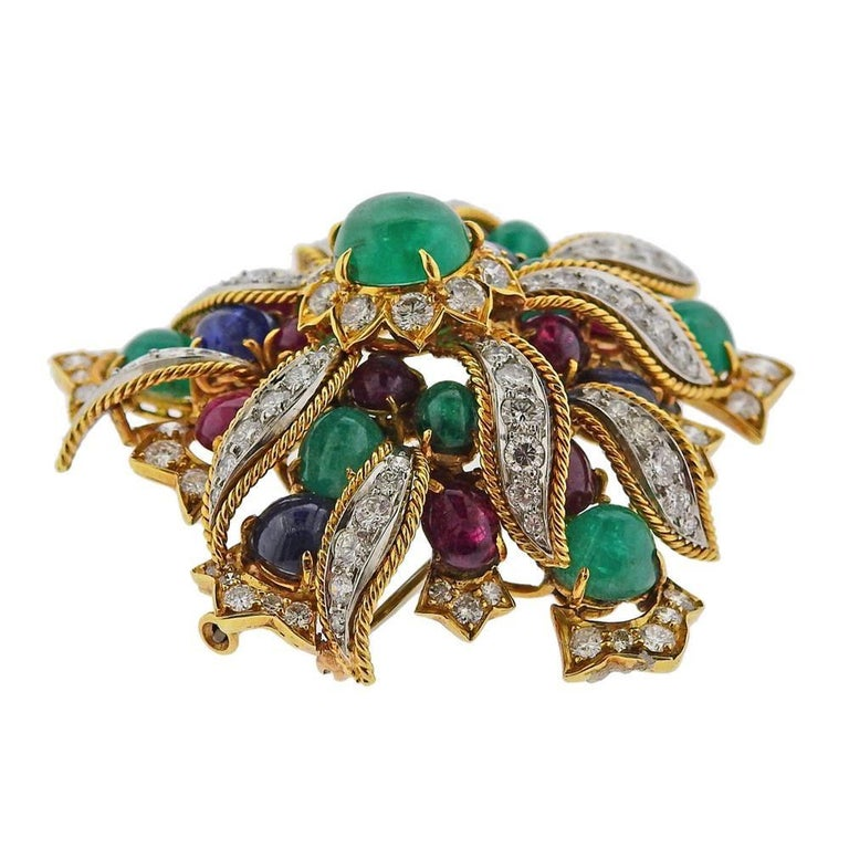 Impressive 18k gold and platinum brooch by David Webb, set with ruby, sapphire and emerald cabochons, and approx. 5.25ctw in diamonds. Brooch is 50mm x 53mm. Marked: Webb 18k, Plat. weight - 38.2 grams.PB-02201