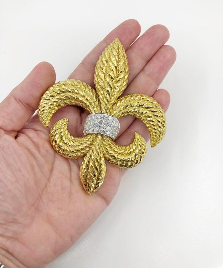 DAVID WEBB Fleur-de-Lis Diamond Detachable Brooch in 18k Yellow Gold and Platinum.  An exquisitely textured gold design emblematic to David Webb, this bold 'fleur-de-lis' lends a nod to the royal arms of France. The extravagance of its size properly