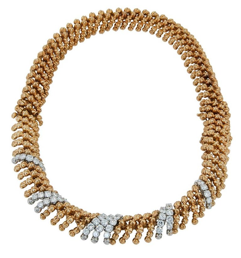 DAVID WEBB Diamond Necklace/Bracelets An 18k yellow gold and platinum two-piece necklace, set with brilliant-cut diamonds. This interchangeable piece can be worn as two bracelets. Necklace measures approx. 15.50″ in total length and for the two
