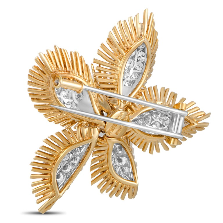 "This David Webb brooch is made of 18K yellow gold and platinum and set with a total of 8.00 carats of diamonds that boast grade F color and VS1 clarity. The brooch weighs 31.2 grams and measures 2.00"" in length and 2.00"" in width."