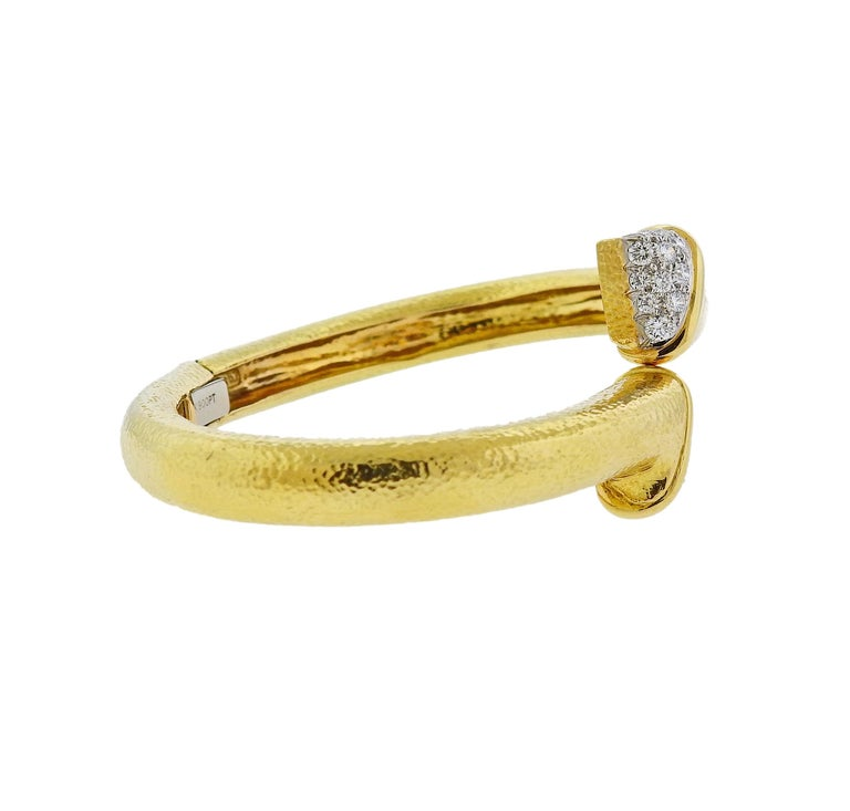 18k yellow gold and platinum crossover bangle bracelet, crafted by David Webb, adorned with approx. 1.40ctw in H/VS-SI diamonds. Retail $10800. Bracelet will fit up to 7