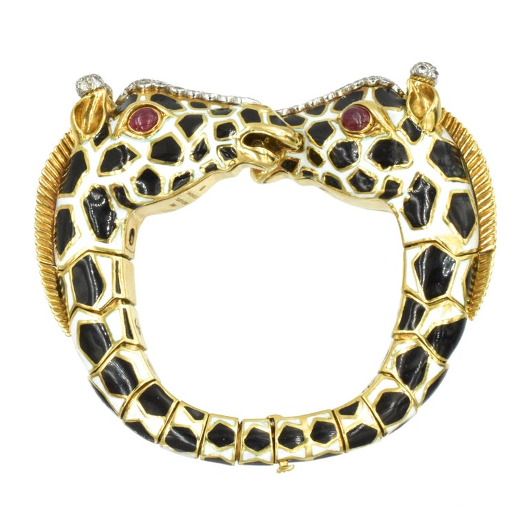 David Webb Diamond, Ruby And Enamel Giraffe Bracelet  In 18k Yellow Gold And Platinum. Set with ruby cabochons and round brilliant cut diamonds weighing total of approximately 2.30ct, color G clarity VS.  Measuring 6 inches long and 0.75 inch wide.