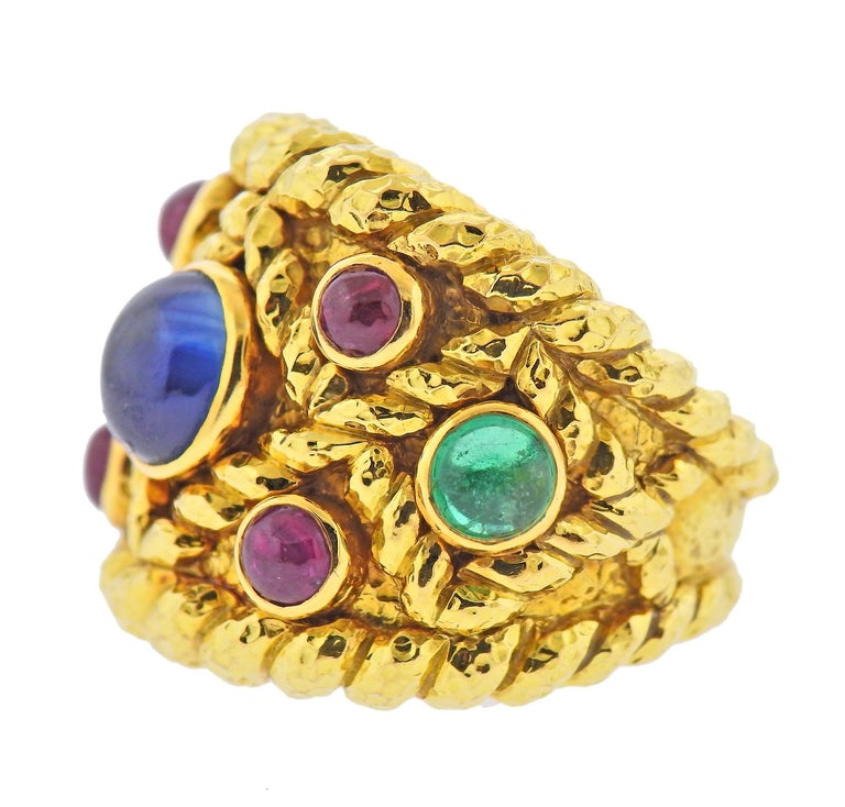 Large 18k hammered gold cocktail ring by David Webb, with sapphire, emerald and ruby cabochons. Ring size - 7, ring top - 25mm wide. Marked: Webb 18k. Weight - 35.9 grams.