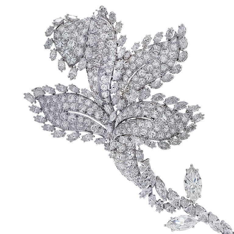 Truly spectacular David Webb brooch pin finely crafted in platinum, showcasing a breathtakingly beautiful flower encrusted in 271 mixed cut diamonds weighing approximately 18.92 carats total, G-H color, VS clarity. This sensational brooch pin is