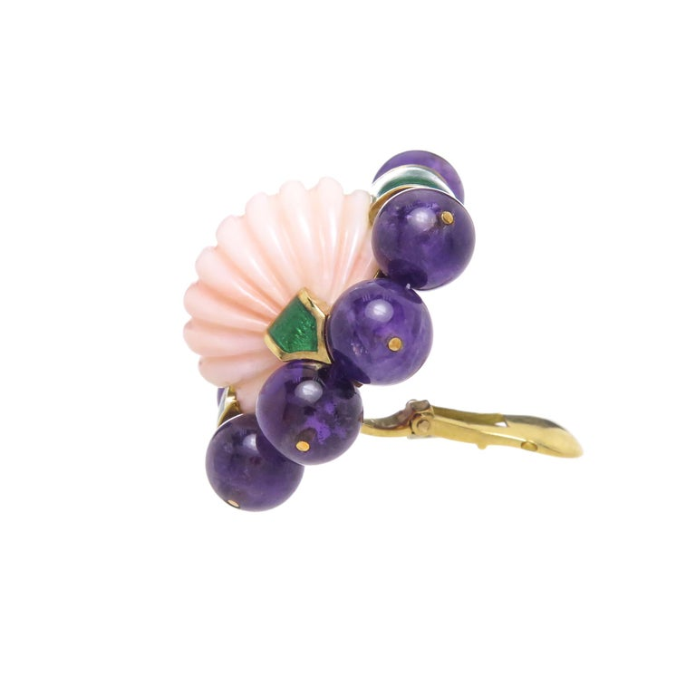 Circa 1970s David Webb 18K Yellow Gold Earrings, measuring 1 1/4 inches in length X 1 1/4 inches. Centrally set with a Domed Scalloped light Pinkish Coral and surrounded by Deep Rich color Amethyst Beads measuring 8 MM, further accented with Green