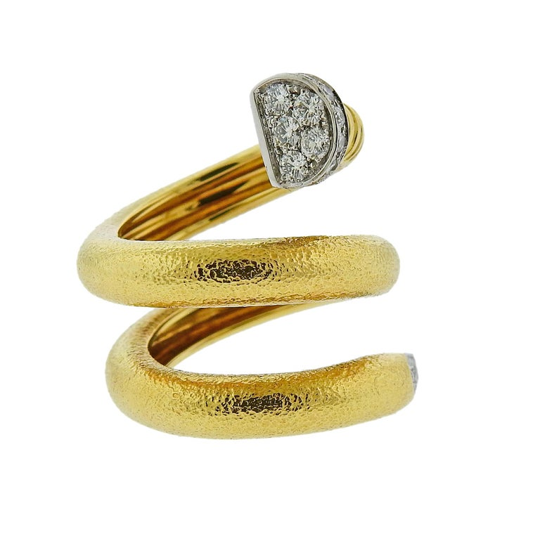 Iconic hammered 18k gold and platinum wrap nail ring, adorned with approx. 0.70ctw in diamonds. Ring size - 6, ring is 30mm wide. Weighs 17.1 grams. Marked: David Webb, 18k, 900pt, 1116.