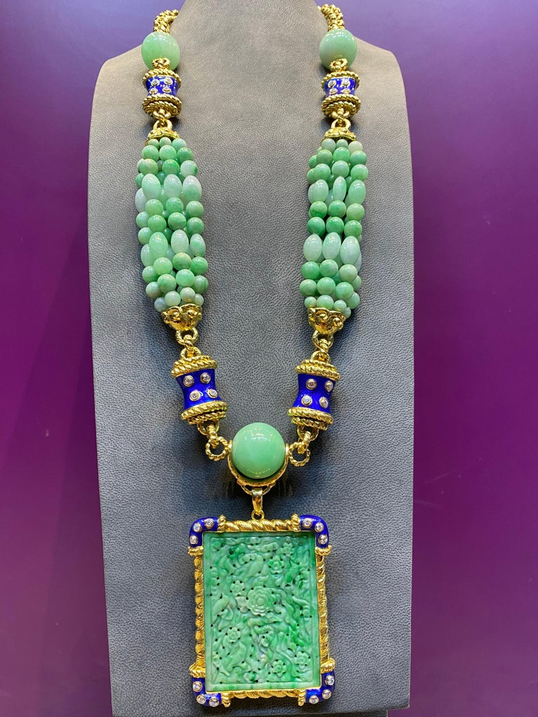 David Webb Jade, Diamond & Enamel Necklace set in 18K Yellow Gold & Platinum with detachable rectangular Jade pendant to be worn two ways. Six strands of jade beads & 3 larger beads attached to a 18k rope & blue enamel link. Necklace Length: