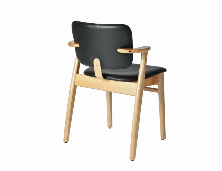 Ilmari Tapiovaara Domus chair in natural oak and leather for Artek. Designed in 1946 and produced by Artek of Finland. Executed in natural lacquered oak wood and black prestige leather on seat and back. Stackable up to four chairs.   Price is per