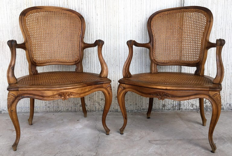 Louis XV carved Provincial Fauteil's with caned seats and backrests with velvet upholstered rigid cushions-seats, carved crests, rails, arms, and legs. Really beautiful and perfect shape.