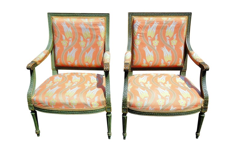 Pair of Louis XVI style distressed painted armchairs.