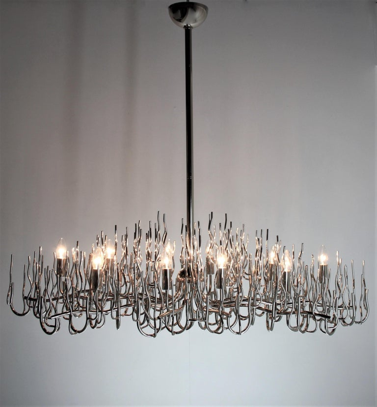 Huge rare large oval chromed bush chandelier, Italy 1970s. This chandelier has ten-light points and has been completely re-wired by a Professional. The chrome is in perfect condition and the height of the chandelier can be reduced if necessary.