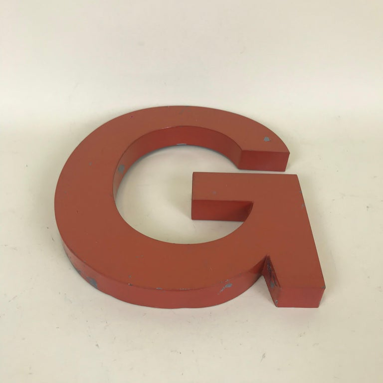 Metal vintage orange capital letter G sign made in France in the 1950s.