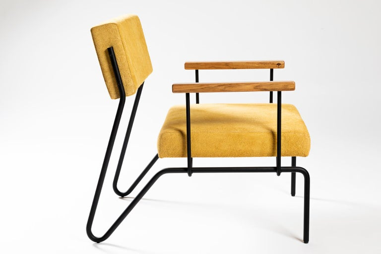 This award winning minimalist armchair in steel, solid wood and leather is designed with a Classic and geometric reasoning.  The continuity of the structural lines suggests fluidity. The backrest allows a smooth movement and just like the seat, it