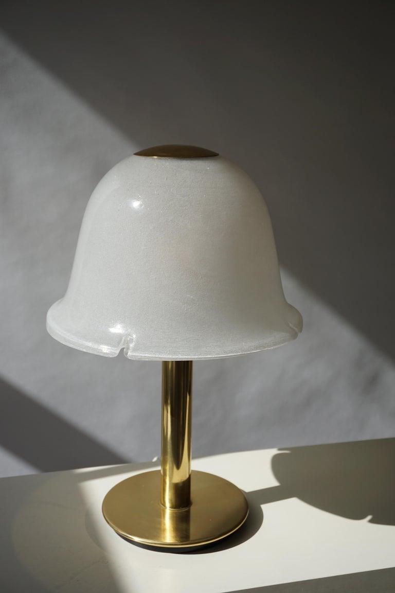 Italian Murano glass and brass table lamp. Measures: Diameter 36 cm. Height 56 cm. One E27 bulb.