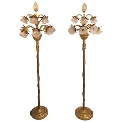 Pair of Neoclassical Style Bronze and Gilt Metal Ten Lights Standing Lamps