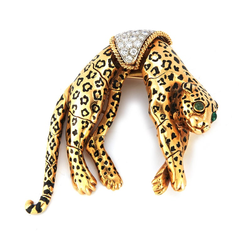 David Webb Panther Brooch  18 karat gold & black enamel with round cut diamonds & 2 emeralds as the eyes  Very well made, it is articulated- the legs move  Measurements: 2.25
