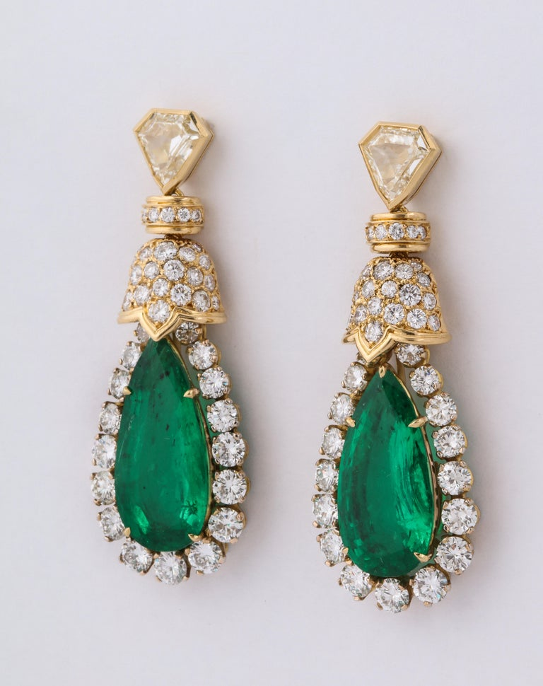 David Webb pear shaped emerald and diamond earrings. 2 pear cut emeralds @ 16 ct tw, 2 kite shaped diamond @ 2 carats J/VVS1, 88 full cut fine white diamonds @ 8.6 cts. 18K gold, 4 gm 22.7 gm. 1 7/8 inches long, 6/8 inches wide, 3/8 inches deep.