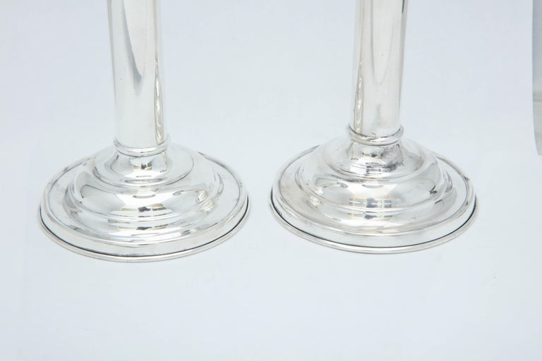 Edwardian pair of sterling silver candlesticks, The Gorham Manufacturing Company, Providence, Rhode Island, circa 1910. Clean lines. Each measures 7 inches high x 3 3/4 inches in diameter across base. Weighted. Dark spots in photos are reflections.