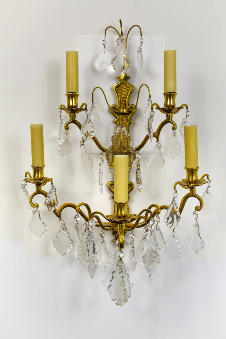 French gilded bronze, double tier, five-arm, candelabra sconces in the Belle Époque style. With heavy, French pendalogue crystals, and polybeeswax candle covers, circa 1910. Newly rewired. Measures: 17