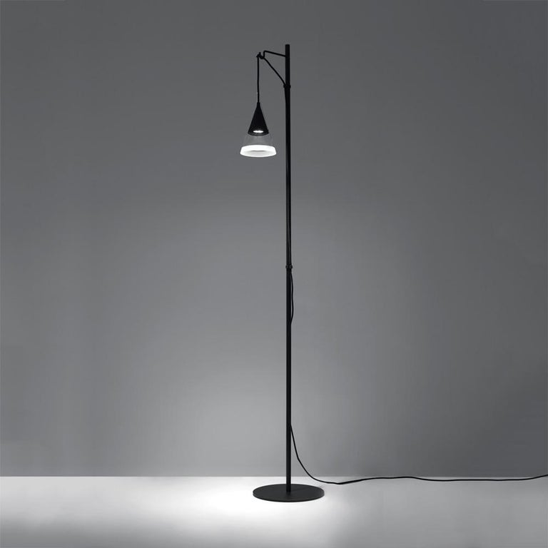 Vigo reinterprets the concept of an old-fashioned street light for domestic environment. Consisting of dual overlapping cones with one placed inside and flush with its mate.  The inner cone is made of black metal while the outer is transparent,