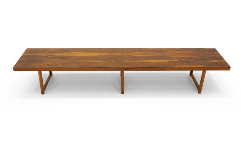 Stunning Brazilian Rosewood, 8 feet long (96 inches), bench (or coffee table) by Milo Baughman for Thayer Coggin. The figuring in the rosewood is exceptional. Free of any scratches, dents, or chips. Condition is excellent. Signed with the Milo