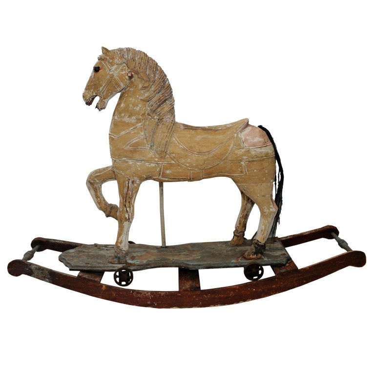 This is a really beautiful French mid 19th century decorative Rocking or Trolley Horse of great character, in its original worn antique condition. Wheeled horse would have been unbolted from rocking base, circa 1870.