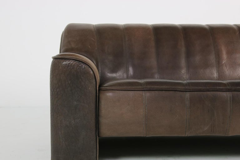 Beautiful three-seat De Sede sofa, in beautiful brown shades, De Sede Mod. DS 44 from the 1970s - out of production. Thick buffalo leather, freestanding. Extendable seat, amazing patina, fantastic condition, super high quality, very heavy weight.