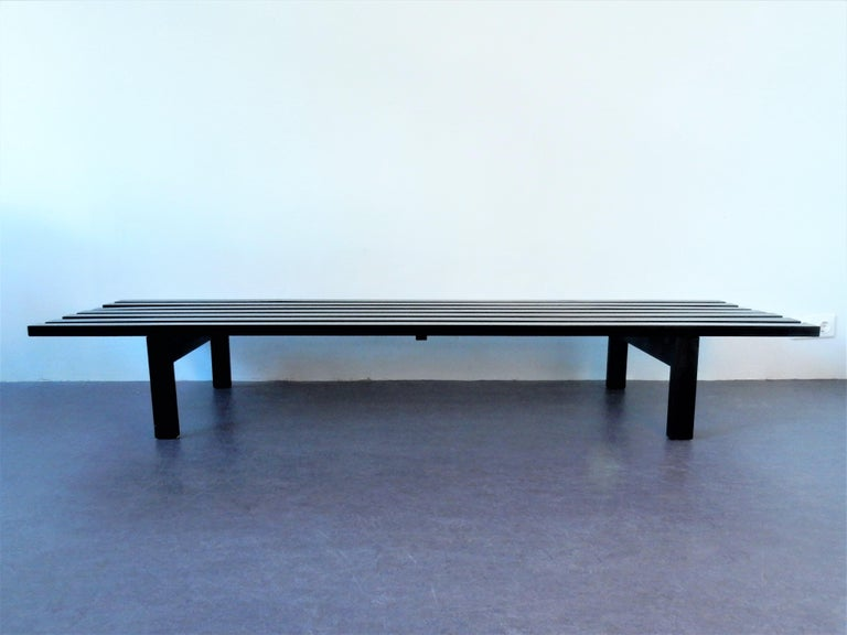 This BZ82 slat bench was designed on request of Stedelijk Museum, Amsterdam, by Martin Visser. It is made of solid, matt varnished ash wood and has the original sliding laminated shelf. It is marked with the label of 't Spectrum underneath the