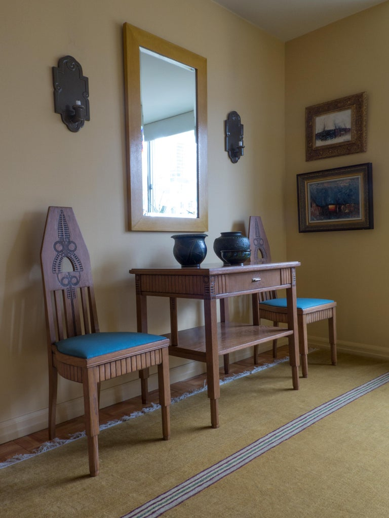 Typical of Nordic, and in particular Finnish Jugend / Art Nouveau works, the chairs boldly play on geometric forms and natural motifs. Each chair beautifully hand-carved. The chairs are sturdy, comfortable, professionally restored, reupholstered and