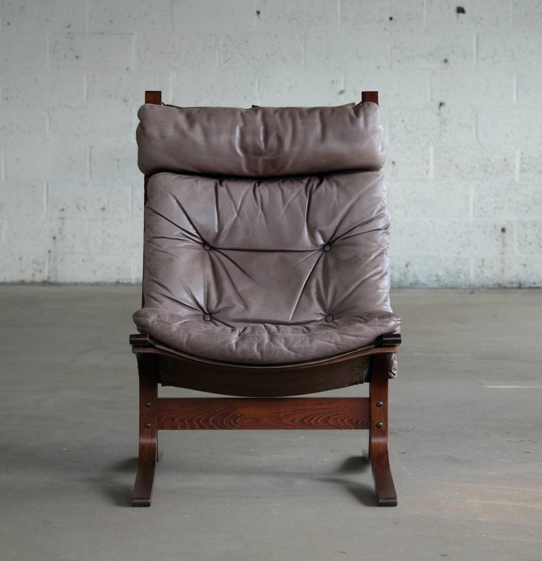 Great easy or lounge chairs in grayish brown or gray colored leather on top of canvas and a frame of stained bentwood. Relling's beautiful take on the classic safari chair designed in 1965. Excellent vintage condition with the leather showing a very