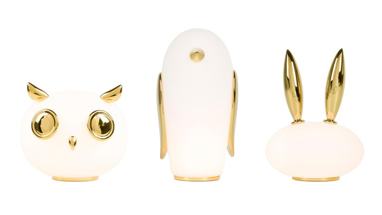 Uhuh, Purr & Noot Noot (owl, rabbit & penguin) are a series of table lamps by Marcel Wanders with their very own personalities and characteristics. They are produced in white opal glass with ornamentation in gold painted ceramic. The Lamps are
