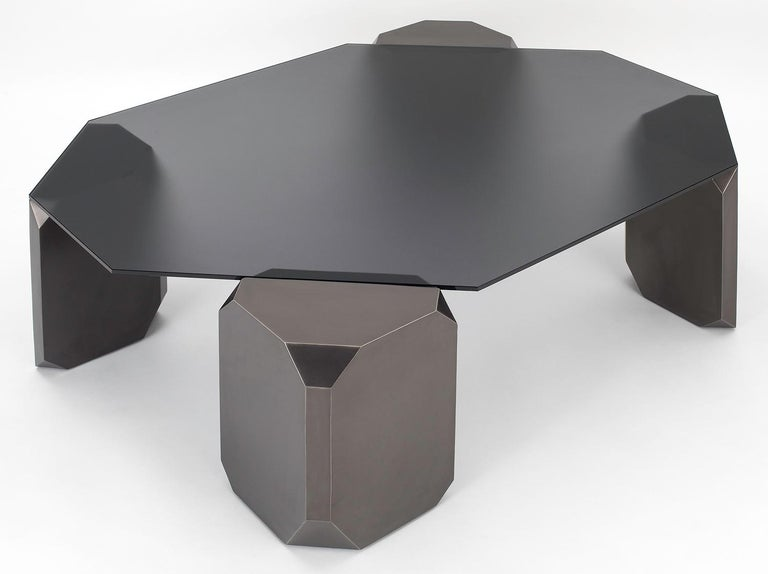 The Stonehenge coffee table combines monumental, sculptural legs with a light etched glass top.