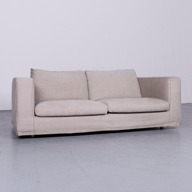 We bring to you an B&B Italia Basiko fabric sofa grey two-seat couch.