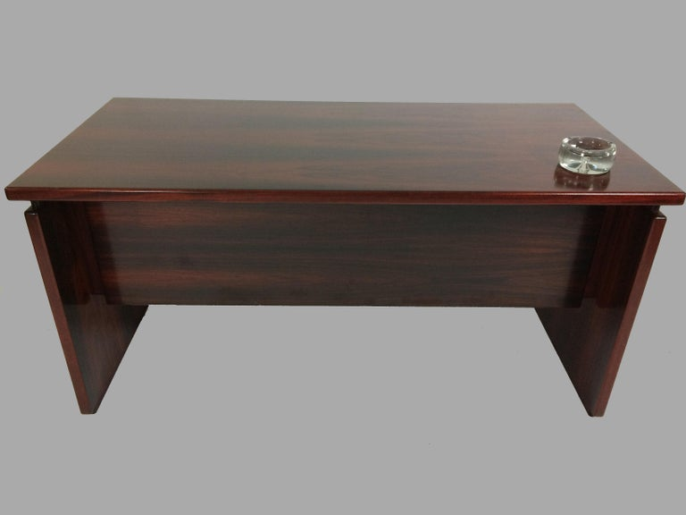 Executive desk from the 1980s designed by Bent Silberg and made by Bent Silberg Mobler.  Only very few desks of this model was produced in rosewood and this desk has been keept stored in it´s original box since it was produced . The desk is designed