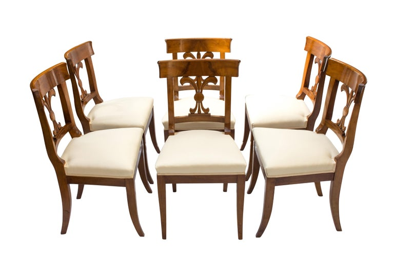 Set of six chairs, Biedermeier, solid walnut-wood. The chairs are new upholstered in the traditional style with straps and feathers. In very good restored condition.  Measure: Seat height 47cm.
