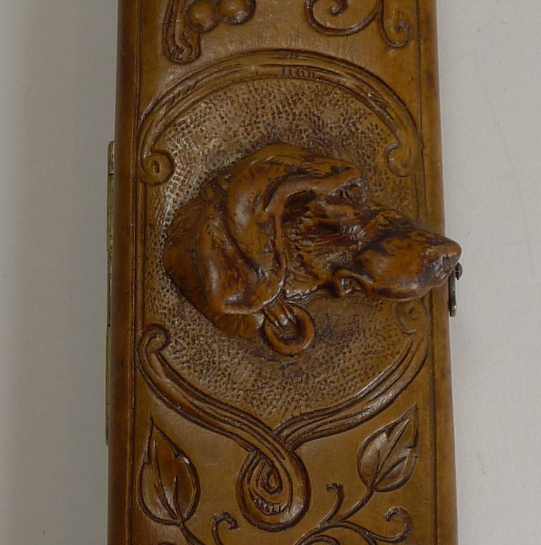 A most unusual piece of Black Forest, a travel desk thermometer in a wooden case with carved decoration and a beautifully carved Dog's head to the front, great detail and beautifully executed.  Dating to circa 1890-1900 it remains in excellent