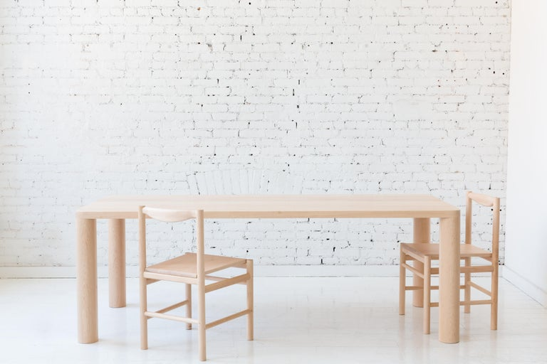 The two inch thick hardwood top features steel supports beautifully inlaid into the bottom of the table top removing the need for any other table base components and maintaining an incredibly simple modern profile.  Made to order in custom sizes,