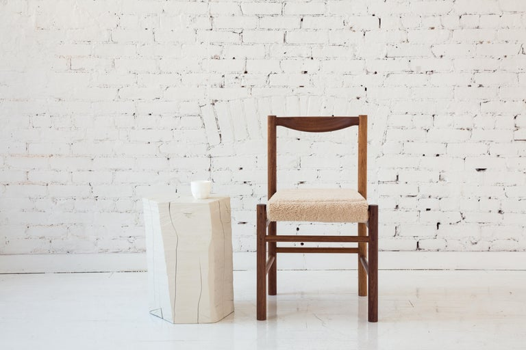 Shaker inspired wood side chair with comfortable contoured backrest. Option for a plain wooden seat pan or a seat pan with a low profile leather or shearling pad. This chair's simplicity makes it versatile to work perfectly in many different