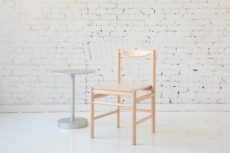 Shaker inspired wood chair with comfortable contoured back rest. Option for a plain wooden seat pan or a seat pan with a low profile leather or shearling pad. This chair's simplicity makes it versatile to work in many different environments.   Shown