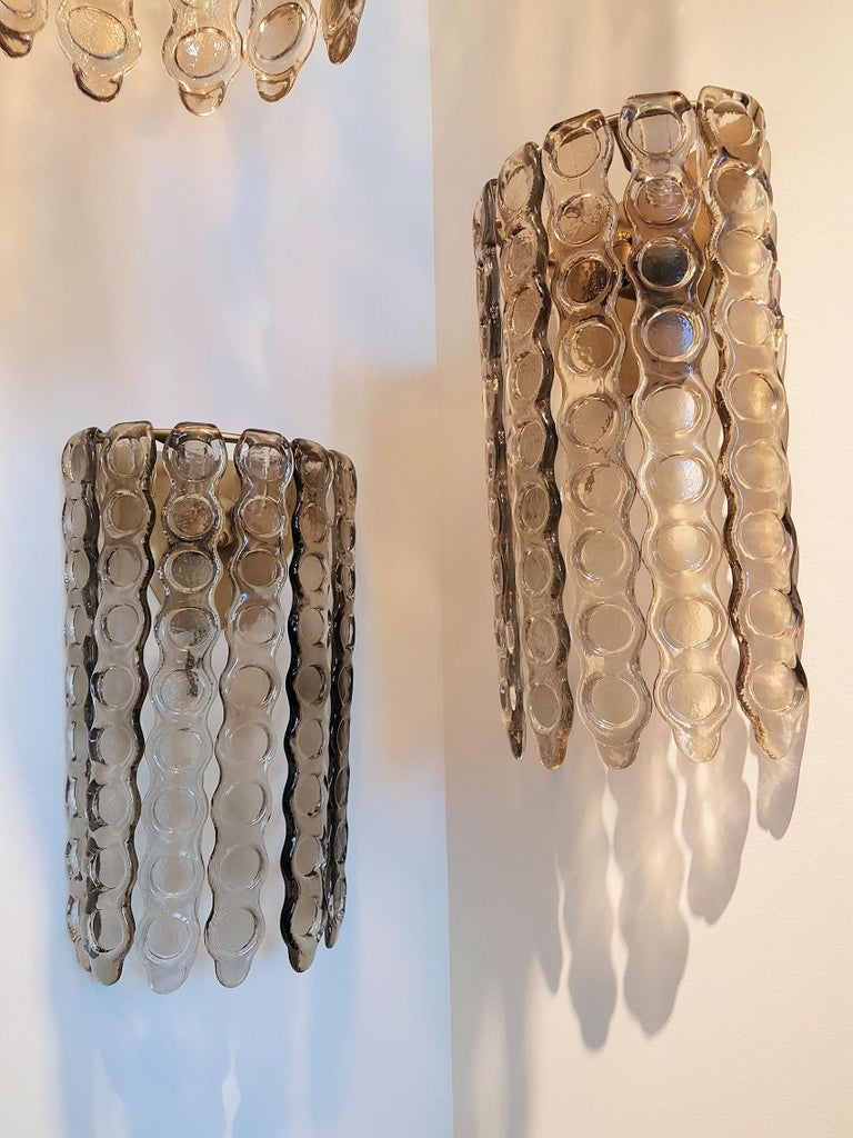 Pair of large smoked textured thick Murano glass wall sconces. In the style of Mazzega, Italy, 1970s. Brass frame two lights each. Rewired. Beautiful handmade thick hooks in light brown color.