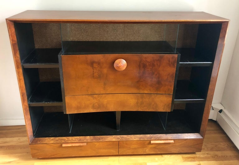Bookcase with drop-front secretary desk and storage drawers in paldao wood. Glass dividers separate storage compartments, and cork-lined back. Retains Herman Miller tag. Great original condition.